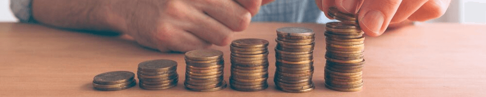 A person stacking coins