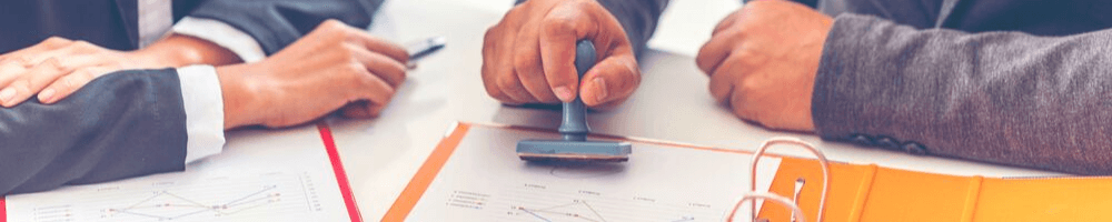 A person stamping a document