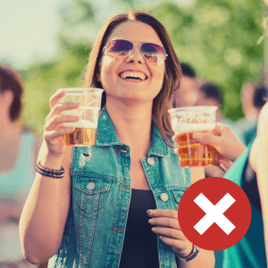 A woman holding a beer in a party atmosphere