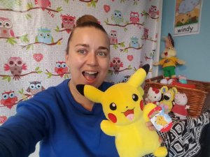 Online TEFL teacher Lindsay holding up a toy pikachu