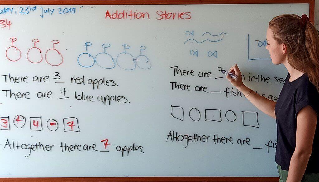 EFL teacher using a whiteboard