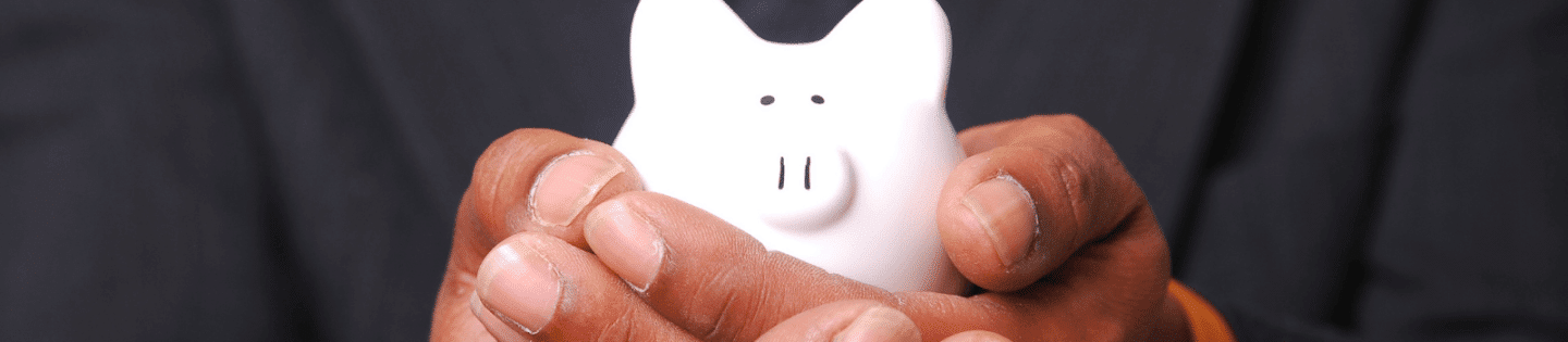A man holding a piggy bank