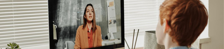 A teacher delivering an online lesson