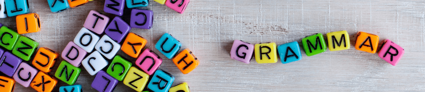 Beads with letters spelling out the word 'grammar'